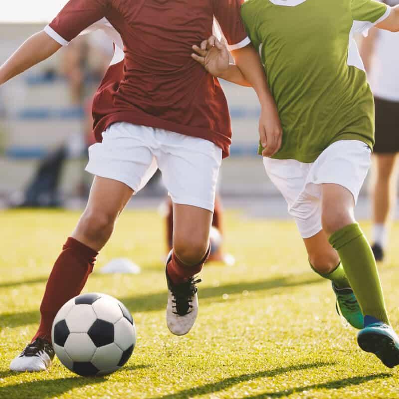 bigstock-Boys-Play-Football-Running-Fo-257570125 (1) (1)