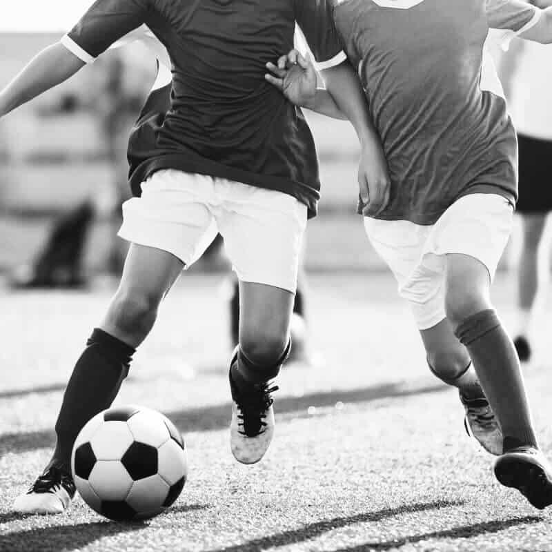 bigstock-Boys-Play-Football-Running-Fo-257570125-1-1 (1)